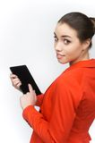 Young woman using touch pad on white background. Stock Photography