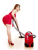 Young woman using vacuum cleaner. Stock Photo