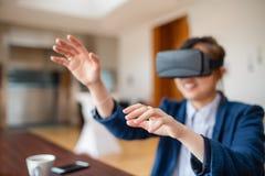 Young woman using virtual reality glasses Stock Image