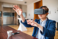 Young woman using virtual reality glasses Stock Images