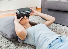Virtual reality glasses woman home Stock Photography
