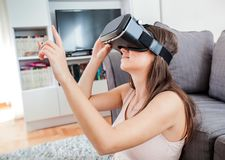 Virtual reality glasses woman home Stock Image