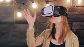 Young woman using Virtual Reality Glasses Stock Photography