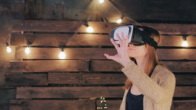 Young woman using Virtual Reality Glasses Stock Image