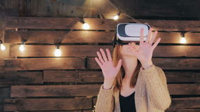 Young woman using Virtual Reality Glasses Royalty Free Stock Photography