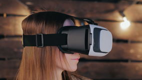 Young woman using Virtual Reality Glasses Royalty Free Stock Image