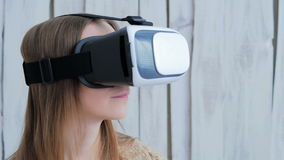 Young woman using Virtual Reality Glasses stock video footage