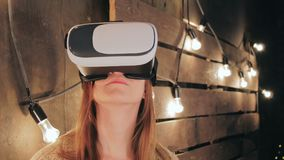 Young woman using Virtual Reality Glasses royalty free stock photos