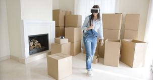 Young woman using a virtual reality headset Stock Photography