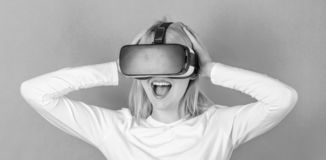 Young woman using a virtual reality headset with conceptual network lines. Excited smiling businesswoman wearing virtual. Reality glasses. Woman wearing virtual royalty free stock image