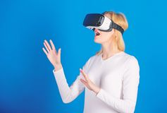 Young woman using a virtual reality headset with conceptual network lines. Woman using VR device. Cheerful smiling woman. Looking in VR glasses. Cyber stock images