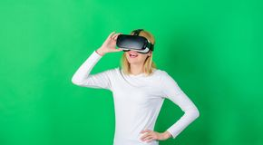 Young woman using a virtual reality headset with conceptual network lines. Woman with virtual reality headset. Cheerful. Smiling woman looking in VR glasses royalty free stock images