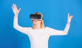 Young woman using a virtual reality headset. Woman enjoying cyber fun experience in vr. Woman with virtual reality royalty free stock image