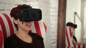 Young woman using virtual reality headset stock video footage