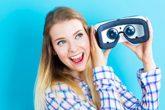 Young woman using a virtual reality headset Stock Image