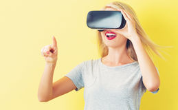 Young woman using a virtual reality headset Stock Photos