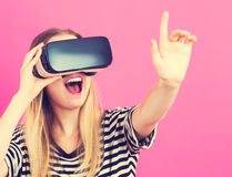Young woman using virtual reality headset Stock Photos