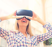 Young woman using virtual reality headset Royalty Free Stock Images