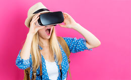 Young woman using virtual reality headset. Happy young woman using a virtual reality headset Stock Photo