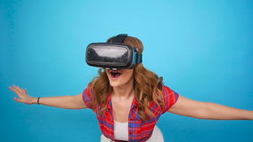Young woman using a virtual reality headset stock video footage