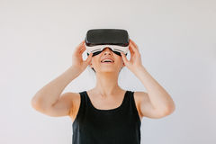 Young woman using the virtual reality headset and smiling Royalty Free Stock Images