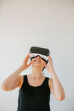 Young woman using the virtual reality headset Royalty Free Stock Photography