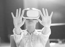 Young woman using vr glasses stock images