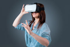 Young woman using a VR headset glasses Stock Photo