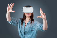 Young woman using a VR headset glasses Royalty Free Stock Photo