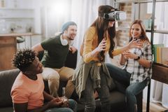 Young woman using VR headset while spending time with friends stock images