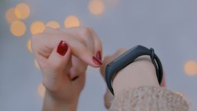Young woman using wearable smart fitness tracker stock footage