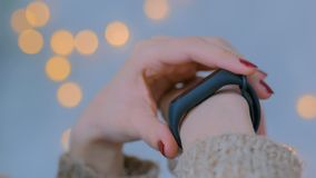 Young woman using wearable smart fitness tracker royalty free stock photos