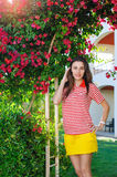 Young woman on vacation in the summer near the exotic flowers Stock Image