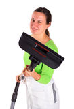 Young woman with vacuum cleaner Royalty Free Stock Photos