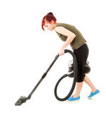 Young woman with a vacuum cleaner Royalty Free Stock Images