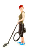 Young woman with a vacuum cleaner Royalty Free Stock Photo