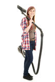 Young woman with a vacuum cleaner Royalty Free Stock Photography