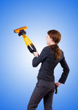 Young woman with vacuum cleaner against gradient Royalty Free Stock Images