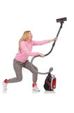 Young woman with vacuum cleaner Royalty Free Stock Photo
