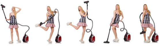 The young woman with vacuum cleaner on white Royalty Free Stock Photos