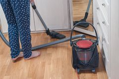 young woman vacuuming the house with the vacuum cleaner. housekeeping concept royalty free stock photos