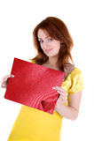 Young woman with valentine's. Young beautiul woman and card with red heart in her hands on white background Stock Photo