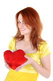 Young woman with valentine's. Young beautiul woman with red heart in her hands on white background. Focus on woman's eyes Stock Photos