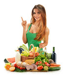 Young woman with variety of grocery products Stock Photos