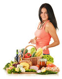 Young woman with variety of grocery products Royalty Free Stock Photos