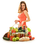 Young woman with variety of grocery products Stock Images
