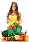 Young woman with variety of grocery products in shopping bag Stock Images
