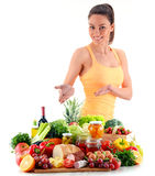 Young woman with variety of organic grocery products on white Stock Images