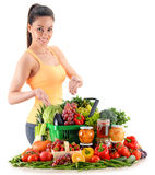 Young woman with variety of organic grocery products on white Royalty Free Stock Photography
