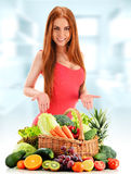 Young woman with variety of organic vegetables and fruits Royalty Free Stock Image